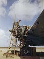 Asisbiz Beaufighter IC RAF 252Sqn under repair note patched over 303 wing gun ports at El Magrun Libya IWM TR901