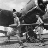 Asisbiz Beaufighter X RAF 211Sqn V NE645 being fitted with 3 inch 60lb rockets SEAC 1944 IWM CH180