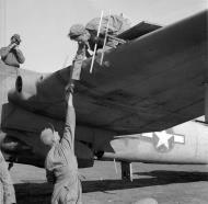 Asisbiz Beaufighter VIF USAAF 12AF 414NFS being rearmed Italy 1944 01