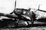 Asisbiz Aircrew FARR Ace Ioan Dicezare is leaning on his Bf 109E3 01