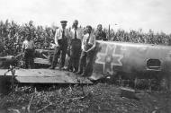 Asisbiz Aircrew FARR personnel gather round a forced landed Bf 109 01