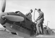 Asisbiz Messerschmitt Bf 109E1 JFS4 Black 5 being refitted with ammunition and fuel 01