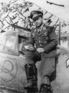 Asisbiz Aircrew Staffelkapitan Hans Assi Han seats on Bf 109E 4.JG2 (W1+ ) assigned to Julius Meimberg 01