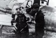 Asisbiz Messerschmitt Bf 109E4B Stab I.JG26 Rolf Pingel putting on his lifevest France Nov 1940 01