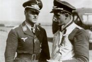 Asisbiz Aircrew Luftwaffe JG26 ace pilot and ex Olympian Joachim Muncheberg being briefed 02