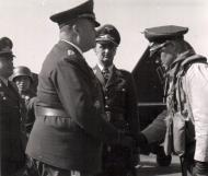 Asisbiz Aircrew Luftwaffe JG26 ace pilot and ex Olympian Joachim Muncheberg with Generals 03