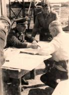 Asisbiz Aircrew Luftwaffe JG26 ace pilot and ex Olympian Joachim Muncheberg with Generals 04