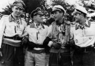 Asisbiz Aircrew Luftwaffe JG26 ace pilot and ex Olympian Joachim Muncheberg with flying comrades 03