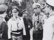 Asisbiz Aircrew Luftwaffe JG26 ace pilot and ex Olympian Joachim Muncheberg with flying comrades 04