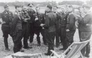 Asisbiz Aircrew Luftwaffe ace JG26 Maj Adolf Galland briefing at Caffiers 01