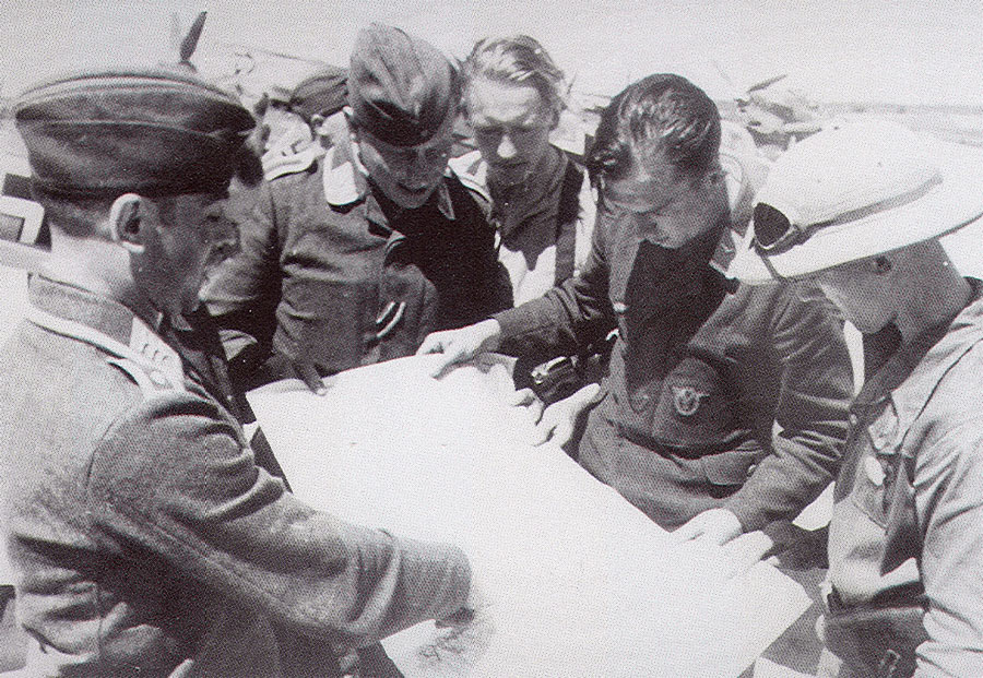Aircrew Luftwaffe ace III.JG27 study their map for a flight to Tripoli 01
