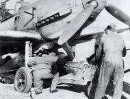 Asisbiz Messerschmitt Bf 109E7B JG54 loading a 250kg bomb France Oct 1940 01