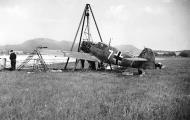 Asisbiz Messerschmitt Bf 109E4 1.JG77 White 7 undergoing engine repairs 1940 01