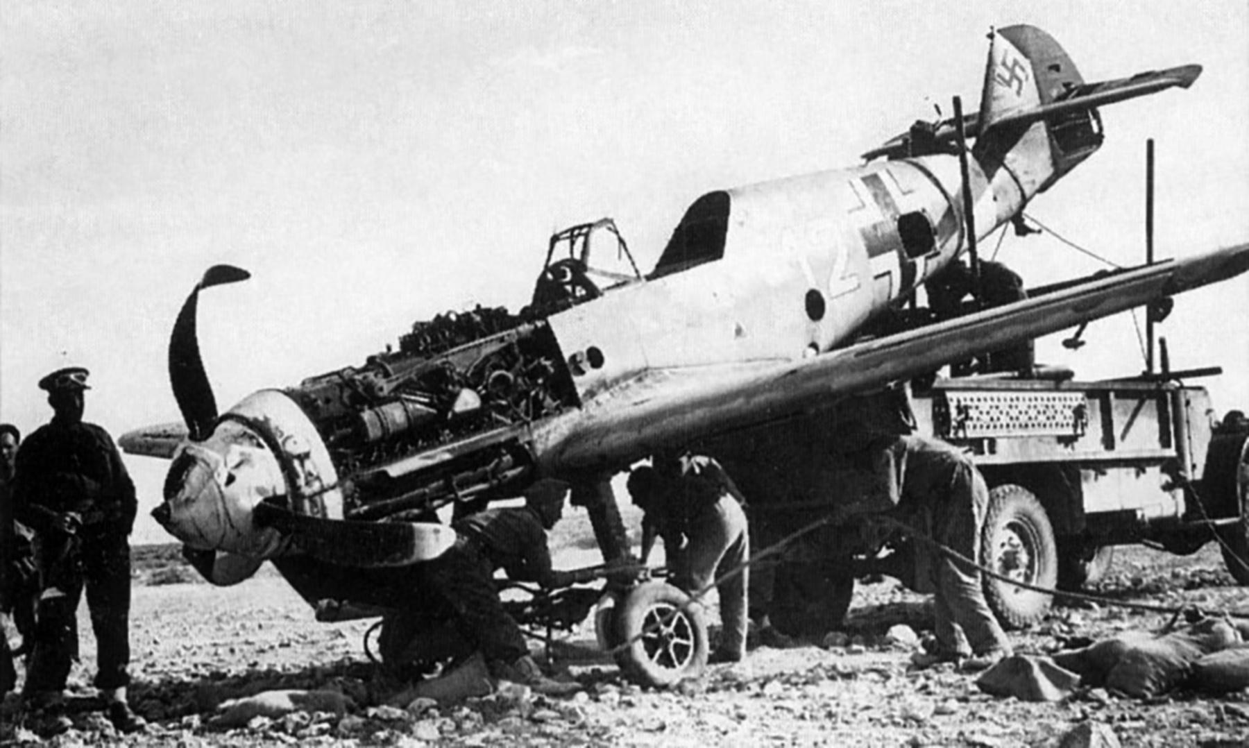 Messerschmitt Bf 109F4Trop 1.JG27 White 12 being salvaged 1941 01