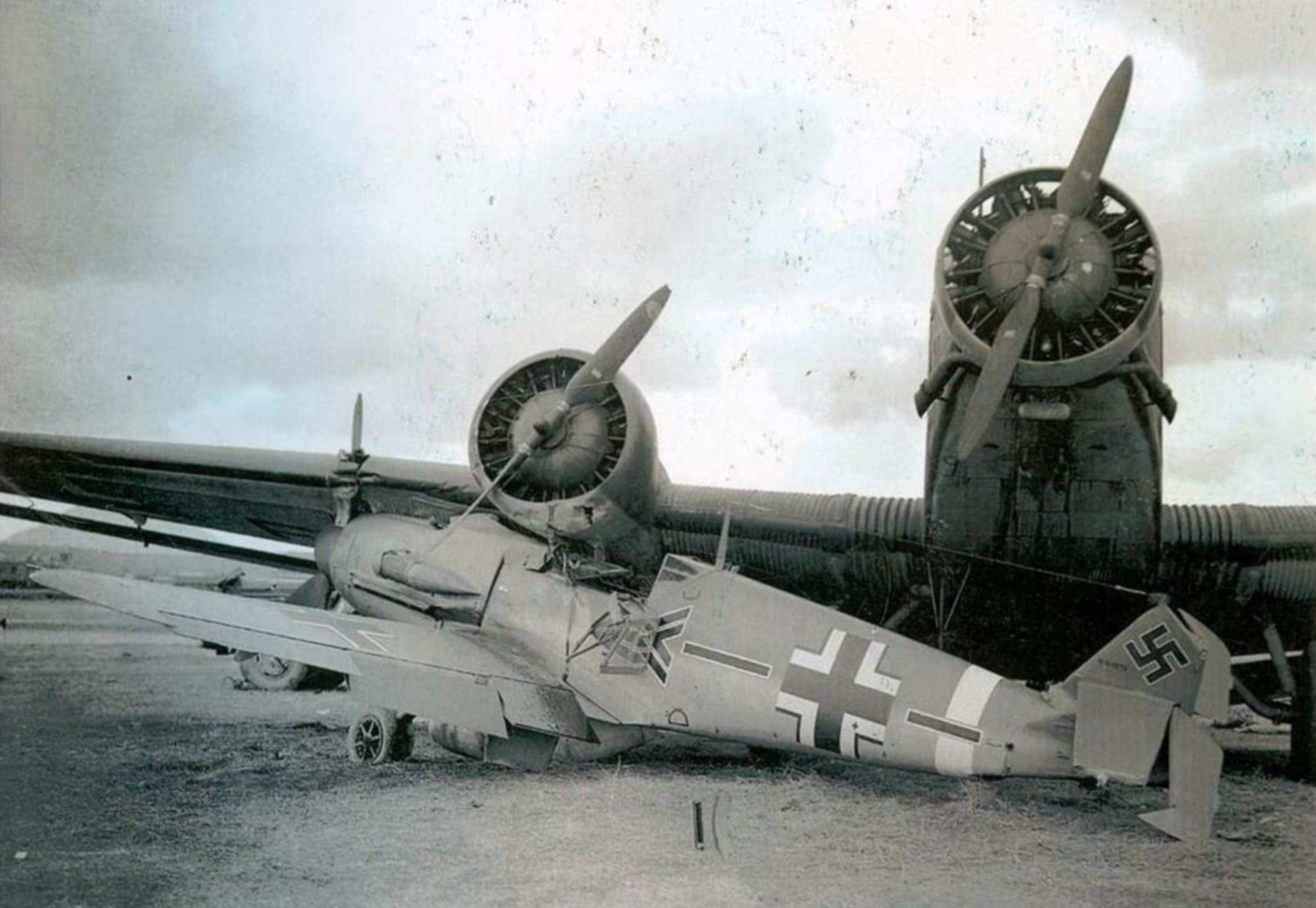 Messerschmitt Bf 109F4Trop Stab II.JG27 WNr 8578 in ground accident with Ju 52.3m Revi 57 2009