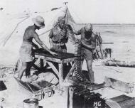 Asisbiz Luftwaffe ground crew 7.JG26 preparing MG 151 ammunition 01