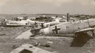 Asisbiz Messerschmitt Bf 109F4Trop 8.JG27 Black 4 abandoned airframe foreground Derna Nov 1942 ebay1