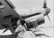 Asisbiz Messerschmitt Bf 109F4Trop II.JG27 loading a BSK gun camera North Africa 1942 ebay1