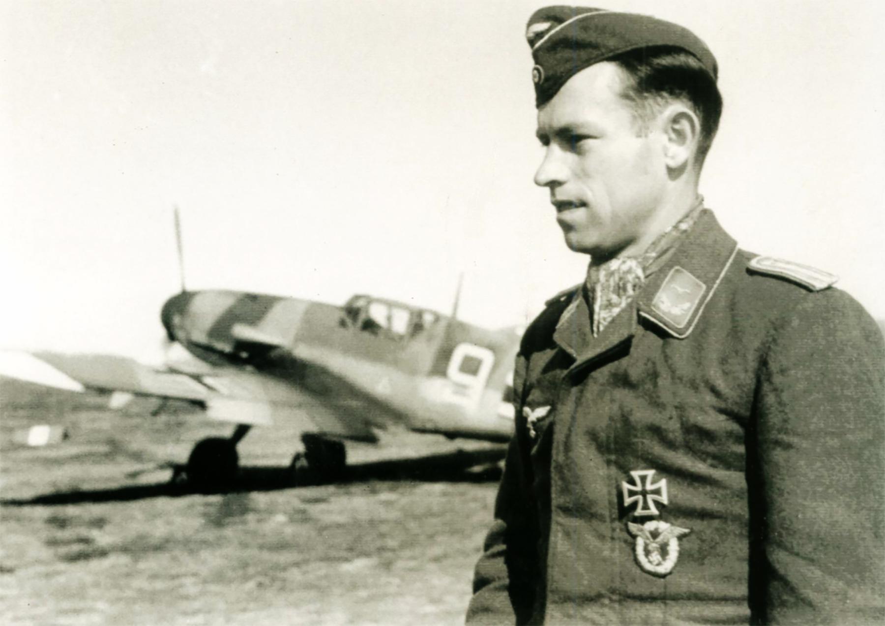 Aircrew Luftwaffe pilot Heinrich Ehrler poses in front of Bf 109F4 4.JG5 (W9+ ) Petsamo Finland 1942 01