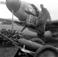 Asisbiz Appling the JG51 emblem onto a Bf 109F2 using a stencil