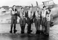 Asisbiz Aircrew Luftwaffe JG3 pilots stand in front of Bf 109G6 5.JG3 Black 6 and Black 5 foreground 01
