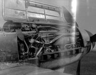 Asisbiz Messerschmitt Bf 109G10 Erla RVT Stab II.JG chevron stands abandoned unknown unit showing DB605D engine 1945 01