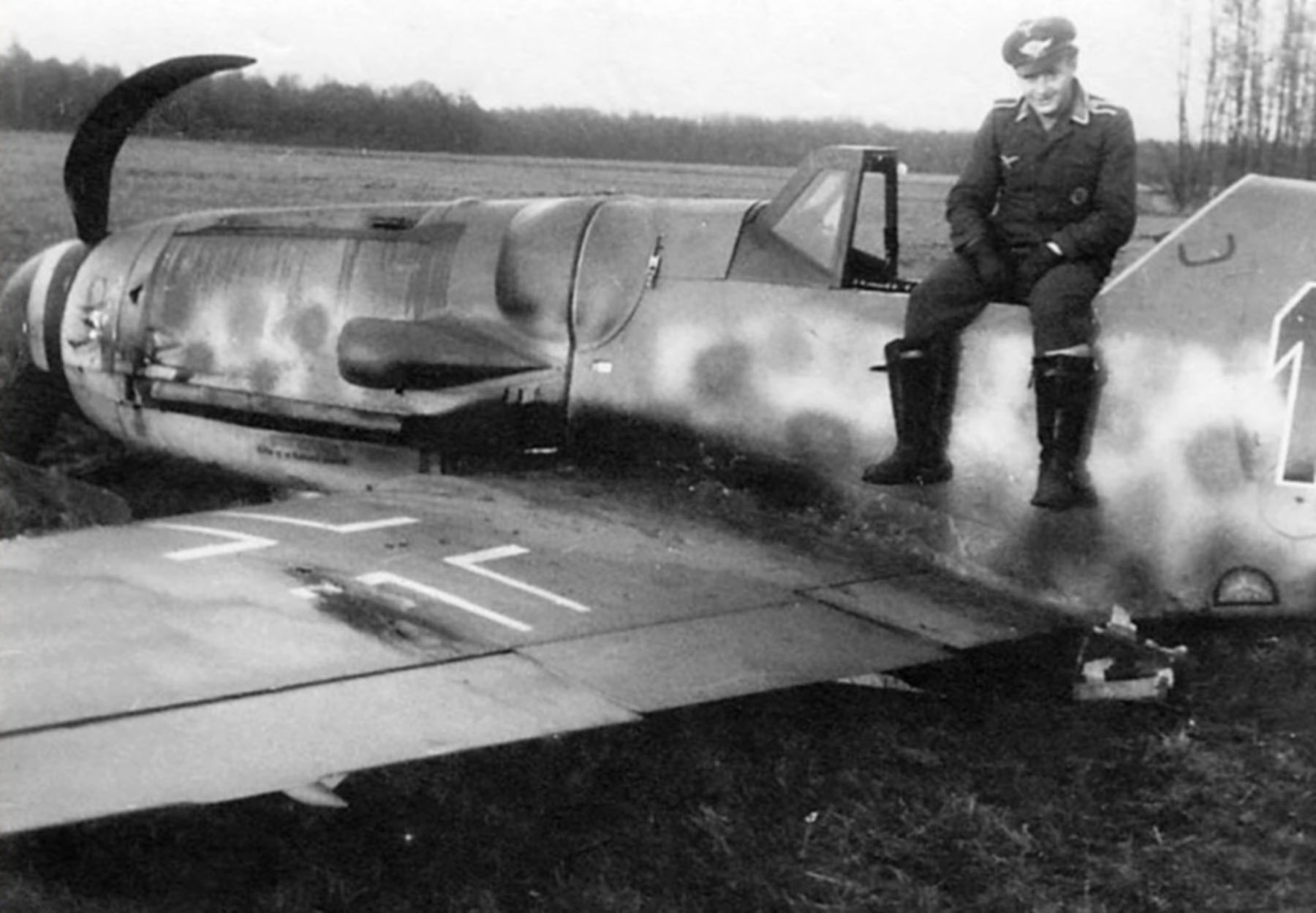 Aircrew Luftwaffe RVT pilot unknown unit with his force landed Bf 109G6 Erla Black 1 01