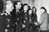 Asisbiz Aircrew Luftwaffe pilots Schnaufer Hitler Hartman receiving Knights Cross Oak Leaves 01