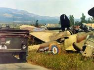Asisbiz German Blenheim graveyard showing various parts with RAF 21Sqn YH background 01