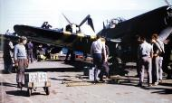 Asisbiz French Navy Vought F4U 7 Corsairs being prepared for Operation Mousquetaire 1956 01