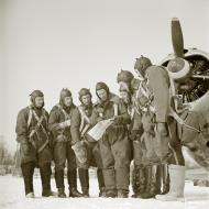 Asisbiz Aircrew Finnish pilots check there map as they plan their mission 17th Mar 1942 77394