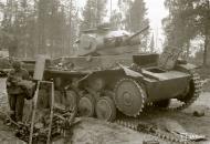 Asisbiz German Panzer II tank knocked out at Kokkosalmen Sohjana road 2nd Aug 1941 33301