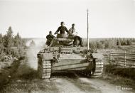 Asisbiz German Panzer III tanks moving to the front lines Vasonvaara 1st Jul 1941 22891