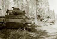 Asisbiz German Panzer III tanks moving to the front lines Vasonvaara 1st Jul 1941 22909
