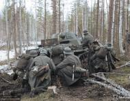 Asisbiz German Wehrmacht Gebirgsjagers with Panzer II tanks during their attack near Louhi heading to Jelettijarvi 15th May 1942 88778c
