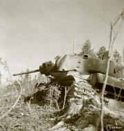 Asisbiz Soviet KV1 tank knocked out by a mine near Syvari power plant 19th Apr 1942 83979
