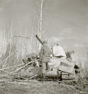 Asisbiz Soviet T34 tank knocked out by a mine near Syvari power plant 19th Apr 1942 83977