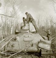 Asisbiz Soviet T34 tank knocked out by a mine near Syvari power plant 19th Apr 1942 83978