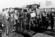 Asisbiz Aircrew Luftwaffe 2.NAG13 Roland Eckersham with Focke Wulf Fw 190A and emblem bgd 1943 01
