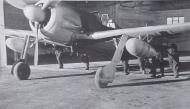 Asisbiz Focke Wulf Fw 190A I.SKG10 being pushed out for arming 01
