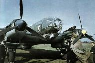 Asisbiz Heinkel He 111H KG26 ground crew covering the engines 01