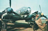 Asisbiz Heinkel He 111H KG26 ground crew covering the engines 02