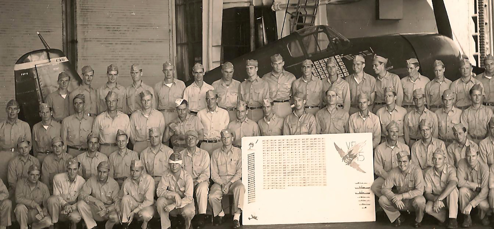 CAG 15 Hellcat BuNo 70143 Dave McCampbell the navy's top ace (seated to the right of the sign) aircraft was lost in Dec 1944 01