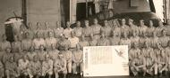 Asisbiz CAG 15 Hellcat BuNo 70143 Dave McCampbell the navy's top ace (seated to the right of the sign) aircraft was lost in Dec 1944 01
