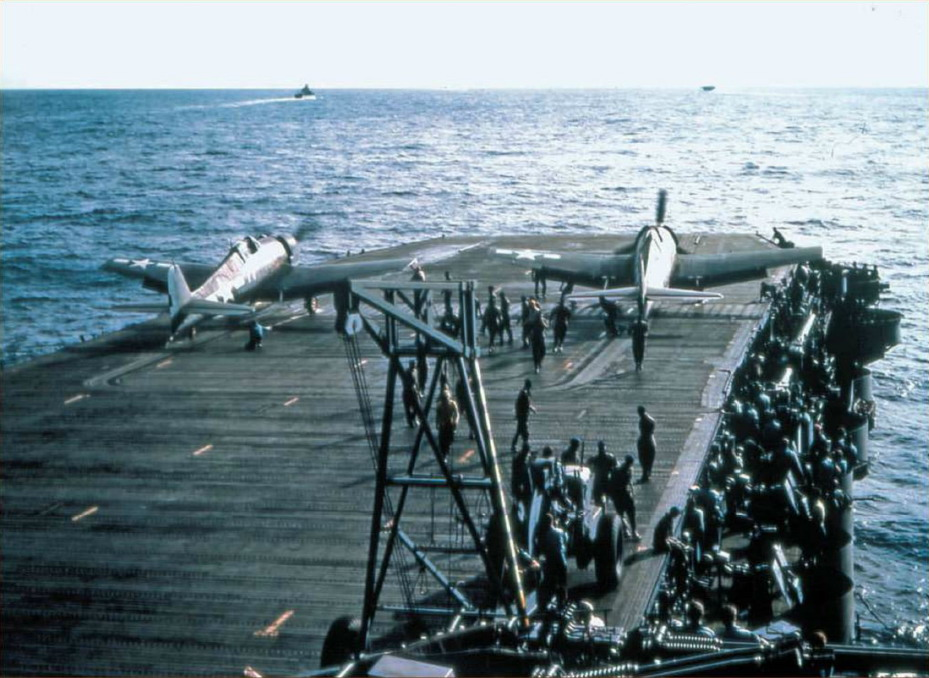 A color photo showing a pair of Grumman F6F 3 Hellcats about to be launched 01