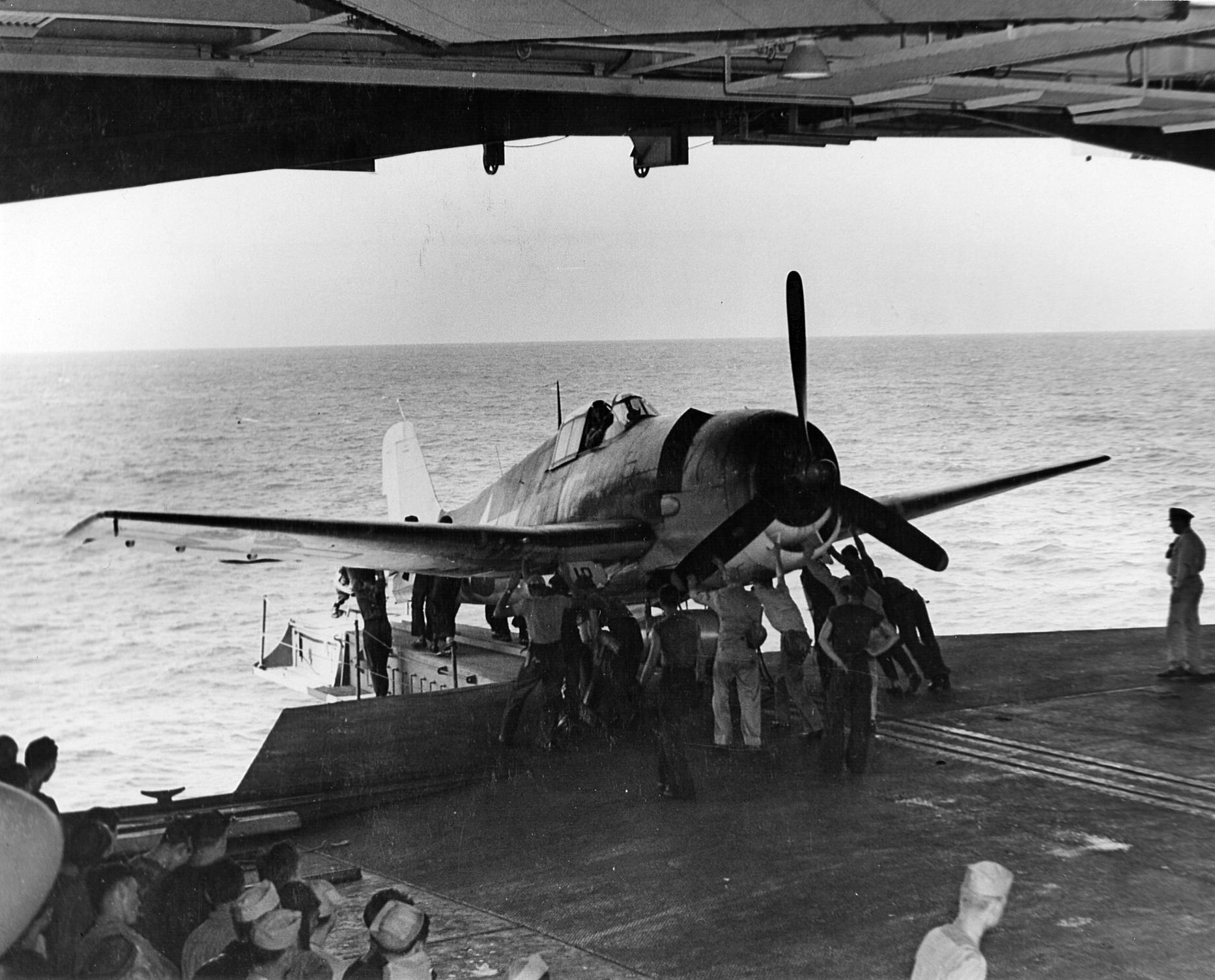 Grumman F6F 3 Hellcat VF 15 being catapulted in a hangar deck launch off CV 12 USS Hornet 01