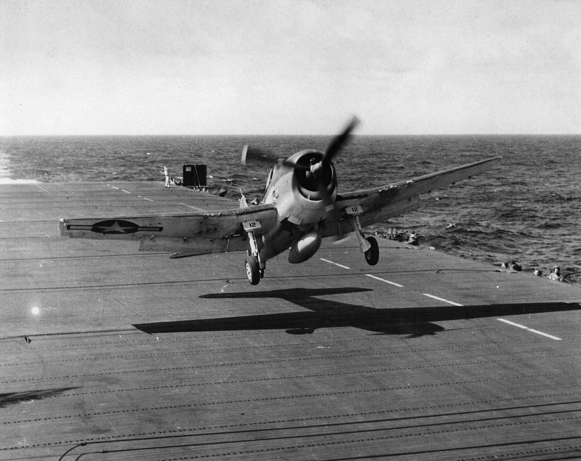 Grumman F6F 3 Hellcat VF 25 White 12 tries to land on CVL 25 USS Cowpens off Hawaii 01