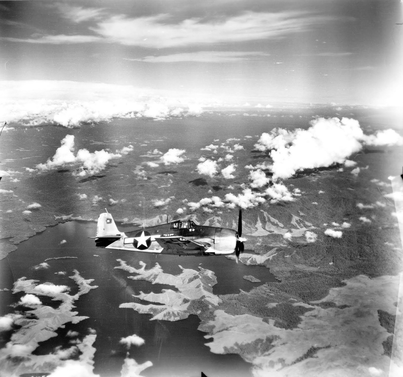 Grumman F6F 3 Hellcat White 315 over Lake Sentani Hollandia CVE 26 USS Sangamon 01