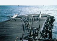 Asisbiz A color photo showing a pair of Grumman F6F 3 Hellcats about to be launched 01