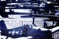 Asisbiz Grumman F6F 3 Hellcat Time Life color photo showing White 34 on a typical crowded flight deck 01